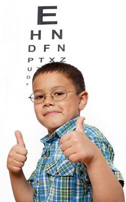 boy-in-front-of-eye-chart-vertical